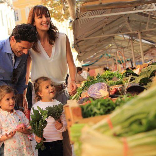 Family in Nice market